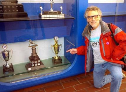 Doug Smith checks out Doug Smith trophy at U of T Athletic Center
